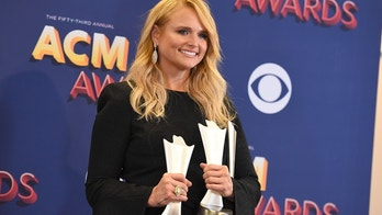 "Miranda Lambert poses in the press room with two awards for song of the year for ""Tin Man"" as performer and song writer, and for female vocalist of the year at the 53rd annual Academy of Country Music Awards at the MGM Grand Garden Arena on Sunday, April 15, 2018, in Las Vegas."