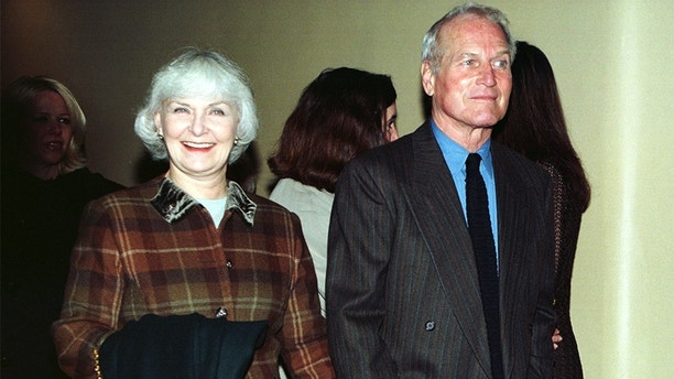 "Actor Paul Newman and his wife Joanne Woodward arrive at the world premiere of the movie ""Twilight"" in New York City, February 18. Newman stars in the film that opens in the U.S. on March 6.