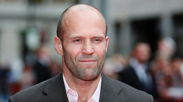 """Actor Jason Statham poses for photographers as he arrives for the world premiere of """"Hummingbird"""", at Leicester Square in central London June 17, 2013. REUTERS/Stefan Wermuth  (BRITAIN - Tags: ENTERTAINMENT SOCIETY) - LM1E96H1F9401"""