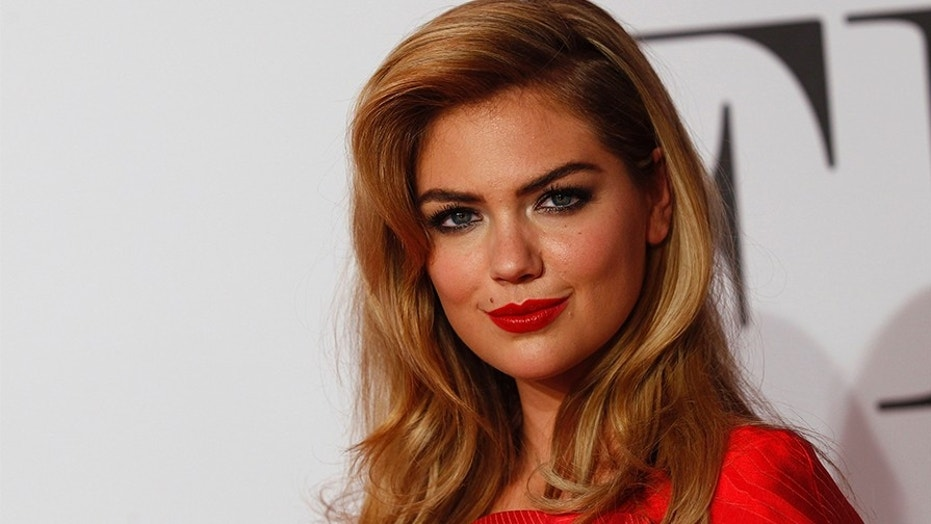 Kate Upton goes topless for a Sports Illustrated Swimsuit photoshoot.