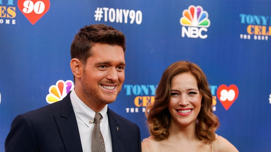 Michael Buble is one proud papa.