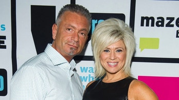WATCH WHAT HAPPENS LIVE -- Pictured: Larry Caputo, Theresa Caputo -- Photo by: Charles Sykes/Bravo/NBCU Photo Bank via Getty Images