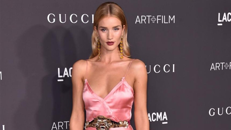 Rosie Huntington-Whiteley poses in sexy red lingerie from her latest Autograph collection.