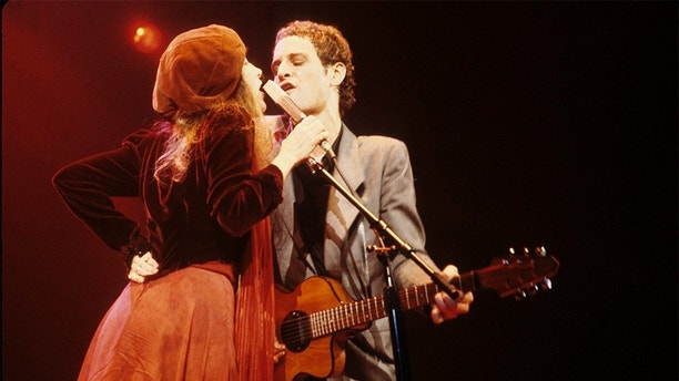 UNITED STATES - JANUARY 01:  Photo of Lindsey BUCKINGHAM and Stevie NICKS and FLEETWOOD MAC; L-R. Stevie Nicks, Lindsey Buckingham performing live onstage  (Photo by Richard E. Aaron/Redferns)