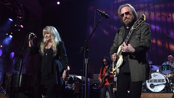 LOS ANGELES, CA - FEBRUARY 10:  Musicians Stevie Nicks (L) and Tom Petty perform onstage during MusiCares Person of the Year honoring Tom Petty at the Los Angeles Convention Center on February 10, 2017 in Los Angeles, California.  (Photo by Lester Cohen/WireImage)