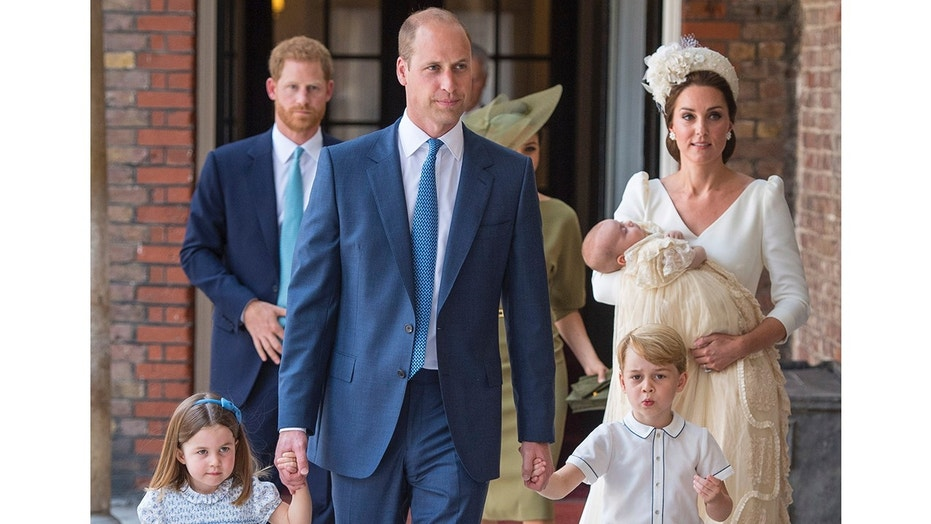 Princess Charlotte and Prince George hold the hands of their father Prince William while Kate, Duchess of Cambridge holds Prince Louis as they arrive for his christening service at the Chapel Royal, St James's Palace, London, Monday, July 9, 2018. (Dominic Lipinski/Pool Photo via AP)