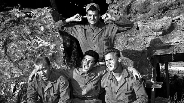"Gary Crosby, Frankie Avalon and Tab Hunter harmonize while Jody McCrea holds his ears against the singing, Jan. 1963. All play members of a naval demolition team in the film ""Bikini"". (AP Photo/Don Brinn)"