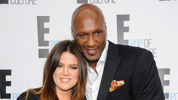 "FILE - In this April 30, 2012, file photo, Khloe Kardashian Odom and Lamar Odom from the show ""Keeping Up With The Kardashians"" attend an E! Network upfront event at Gotham Hall in New York. A Los Angeles judge on Friday, Dec. 9, 2016, finalized Kardashian and Odom's divorce nearly three years after she first filed to end their marriage. The pair were married in September 2009 and court records show many financial details of 