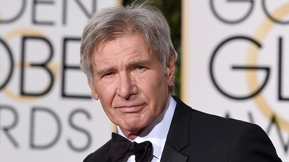"""In this Jan. 10, 2016 file photo, Harrison Ford arrives at the 73rd annual Golden Globe Awards in Beverly Hills, Calif. The Walt Disney Co. on Tuesday announced that the planned fifth installment in the """"Indiana Jones"""" franchise will be released in July 2021 instead of July 2020. The film was originally scheduled for release in the summer of 2019. Steven Spielberg is set to direct the latest film, with Ford also reprising his role."""