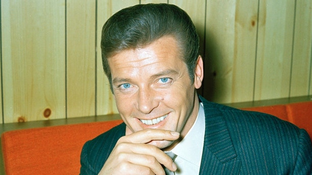 "FILE - This is a May 1968 file photo of British actor Roger Moore of ""The Saint""  and James Bond fame. Roger Moore's family said Tuesday May 23, 2017 that the  former James Bond star has died after a short battle with cancer  (AP Photo/ File)"