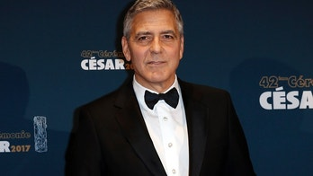 Actor George Clooney holds his trophy during a photocall after receiving an Honorary Cesar Award at the 42nd Cesar Awards ceremony in Paris, France, February 24, 2017.