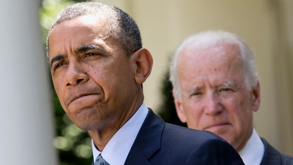 President Barack Obama, accompanied by Vice President Joe Biden, pauses while making an announcement about immigration reform in the Rose Garden of the White House in Washington., June 30, 2014.