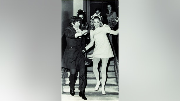 Jun 01, 1968; Hollywood, California, USA; 1968, Pictured: CLOTHING, ROMAN POLANSKI, SHARON TATE, WEDDING, WEDDING GOWN, WEDDINGS/BRIDES, OVERBALANCING, RUNNING..  (Credit Image: Austral/ZUMAPRESS.com)