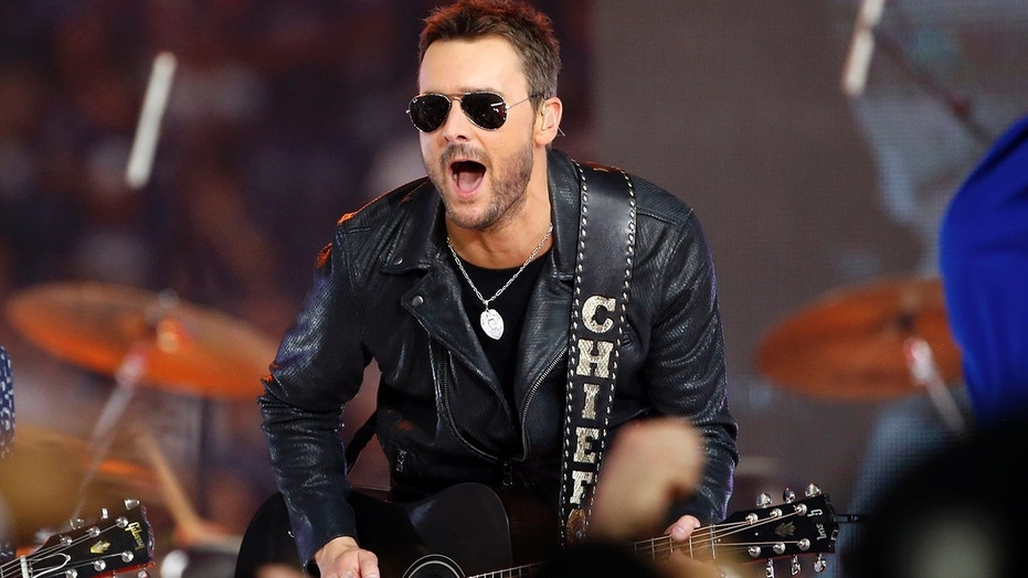In this Nov. 24, 2016, file photo, Country music singer Eric Church performs at halftime during an NFL football game between the Washington Redskins and Dallas Cowboys in Arlington, Texas.