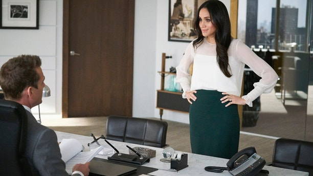 """Tiny Violin"" Episode 715 -- Pictured: (l-r) Gabriel Macht as Harvey Specter, Meghan Markle as Rachel Zane."