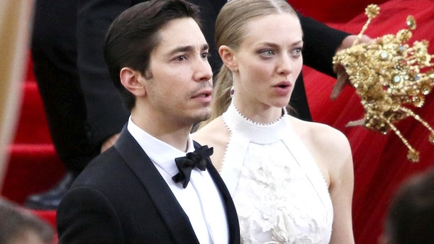 Amanda Seyfried and Justin Long leaving the Met Gala on May 4, 2015 in New York City.