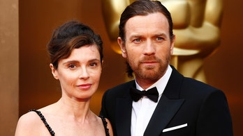 Actor Ewan McGregor and his wife Eve Mavrakis arrive at the 86th Academy Awards in Hollywood, California March 2, 2014.