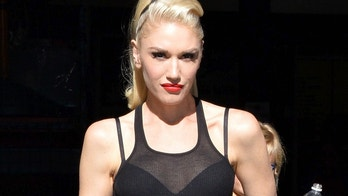 Gwen Stefani is spotted leaving a Burbank pizza shop with her boys, after taking them to Toy-R-Us for a shopping spree. The single-mom has her hair pulled into a high ponytail, with a black see-through muscle-shirt on April 16, 2016.