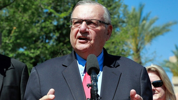 FILE - In this May 22, 2018 file photo, former Maricopa County Sheriff Joe Arpaio speaks during a campaign event in Phoenix. The U.S. Justice Department says an appeals court overstepped its bounds when it ordered the appointment of a special prosecutor to pursue an appeal over retired Sheriff Joe Arpaio's pardon for his contempt of court conviction. (AP Photo/Matt York, File)