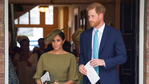 Britain's Prince Harry and Meghan Duchess of Sussex leave after the christening service of Prince Louis at the Chapel Royal, St James's Palace, London, Monday, July 9, 2018. (Dominic Lipinski/Pool Photo via AP)