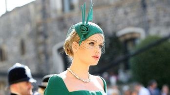 Lady Kitty Spencer arrives at St George's Chapel at Windsor Castle for the wedding of Meghan Markle and Prince Harry.  Saturday May 19, 2018.  Gareth Fuller/Pool via REUTERS - RC1935BF3E00
