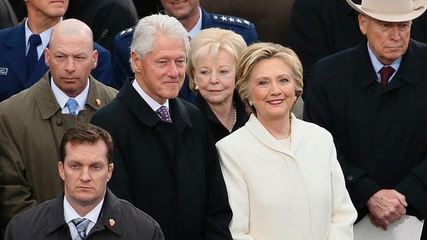 Former Secretary of State Hillary Clinton arrives with her husband former President Bill Clinton during inauguration ceremonies swearing in Donald Trump as the 45th president of the United States on the West front of the U.S. Capitol in Washington, U.S., January 20, 2017. REUTERS/Rick Wilking - HT1ED1K18ZBUA
