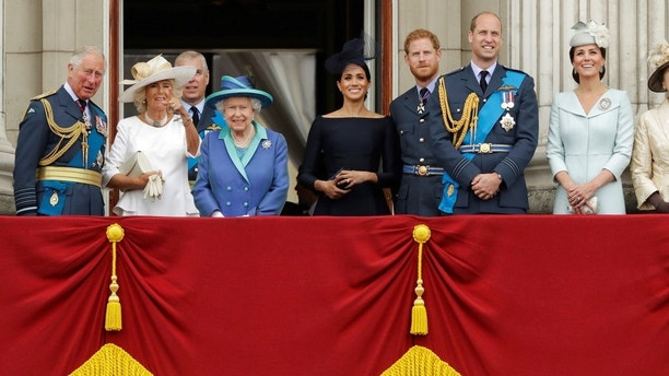 Members of the royal family gather on the balcony of Buckingham Palace, with from left, Prince Charles, Camilla the Duchess of Cornwall, Prince Andrew, Queen Elizabeth II, Meghan the Duchess of Sussex, Prince Harry, Prince William and Kate the Duchess of Cambridge, as they watch a flypast of Royal Air Force aircraft pass over Buckingham Palace in London, Tuesday, July 10, 2018. Various events were held Tuesday to mark 100-years since the formation of the RAF. (AP Photo/Matt Dunham)