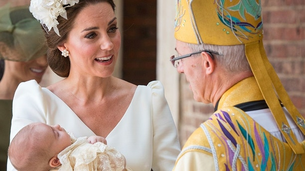 Kate, Duchess of Cambridge speaks to Archbishop of Canterbury Justin Welby as she arrives carrying Prince Louis for his christening service at the Chapel Royal, St James's Palace, London, Monday, July 9, 2018. (Dominic Lipinski/Pool Photo via AP)