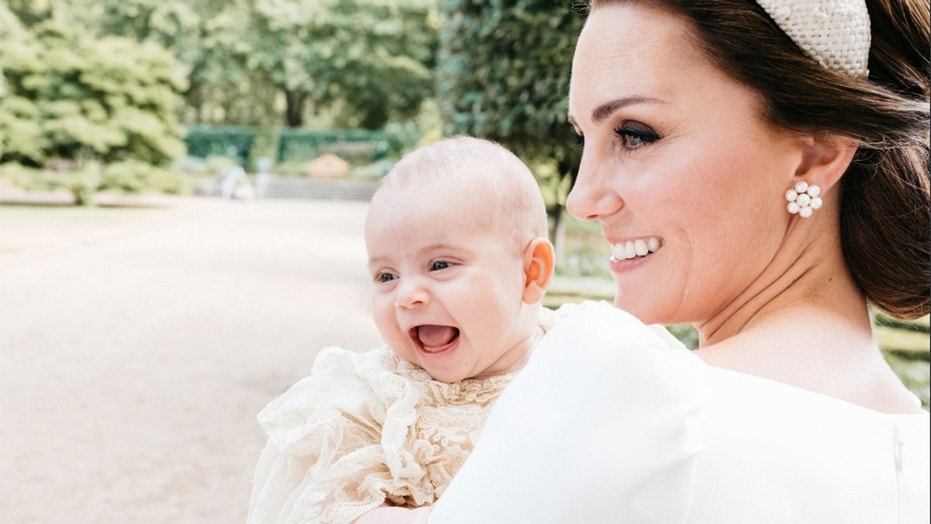 The Duchess of Cambridge poses with her son Prince Louis.
