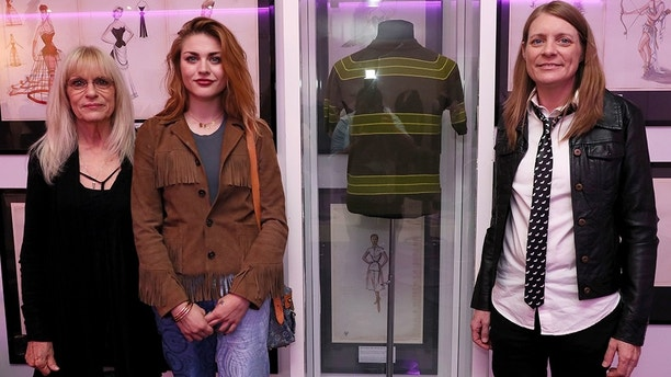 July 17, 2018 - Newbridge, Republic of Ireland - Kurt Cobain's mother Wendy O'Connor (left) daughter Frances Bean Cobain (centre) and sister Kim Cobain stand alongside his t-shirt worn in the 'Smells Like Teen Spirit' video, during the opening of the 'Growing Up Kurt' exhibition on the life of the Nirvana frontman, at the museum of Style Icons in Newbridge, Ireland. (Credit Image: © Brian Lawless/PA Wire via ZUMA Press)