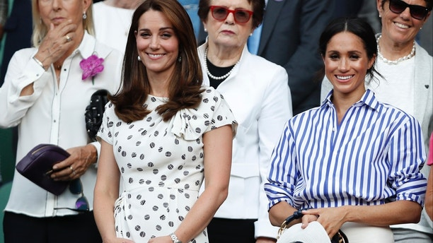 Kate, Duchess of Cambridge and Meghan, Duchess of Sussex, right, watch the women's singles final match between Serena Williams of the US and Angelique Kerber of Germany at the Wimbledon Tennis Championships, in London, Saturday July 14, 2018. (Nic Bothma, Pool via AP)