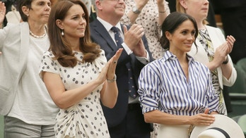 Kate, Duchess of Cambridge and Meghan, Duchess of Sussex, right, applaud after Novak Djokovic of Serbia defeated Rafael Nadal of Spain in the men's singles semifinal match at the Wimbledon Tennis Championships, in London, Saturday July 14, 2018. (AP Photo/Tim Ireland)