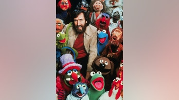 American puppeteer, creator of the Muppets and motion pictures, Jim Henson, poses with his creation characters in The Muppets TV show.