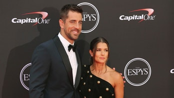 Green Bay Packers quartertback Aaron Rodgers, left, and host Danica Patrick arrive at the ESPY Awards at Microsoft Theater on Wednesday, July 18, 2018, in Los Angeles. (Photo by Willy Sanjuan/Invision/AP)