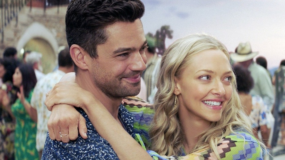 "Dominic Cooper, left, opens up about working with ex Amanda Seyfried, right, on ""Mamma Mia! Here We Go Again."""
