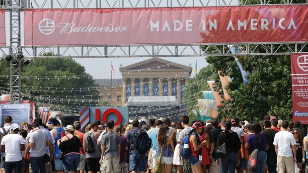 """FILE – In this Sept. 1, 2012, file photo, people line up to enter the """"Made in America"""" music festival, with the Philadelphia Museum of Art visible in the distance on the Benjamin Franklin Parkway in Philadelphia. Jay-Z, who founded the festival in 2012, is expressing disappointment after Philadelphia city officials confirmed Tuesday, July 17, 2018, that the annual Labor Day weekend music festival will no longer be held on the Benjamin Franklin Parkway in """"the heart of the city"""" after the 2018 event, according to The Philadelphia Inquirer. (AP Photo/Matt Rourke, File)"""