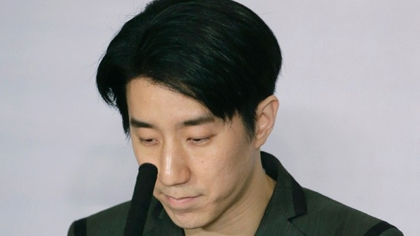 Hong Kong actor Jaycee Chan pauses during a news conference at a hotel in Beijing Saturday, Feb. 14, 2015. Chan, son of actor Jackie Chan has apologized and asked for a second chance following his release from a six-month jail sentence for allowing people to use marijuana in his apartment. (AP Photo/Andy Wong)