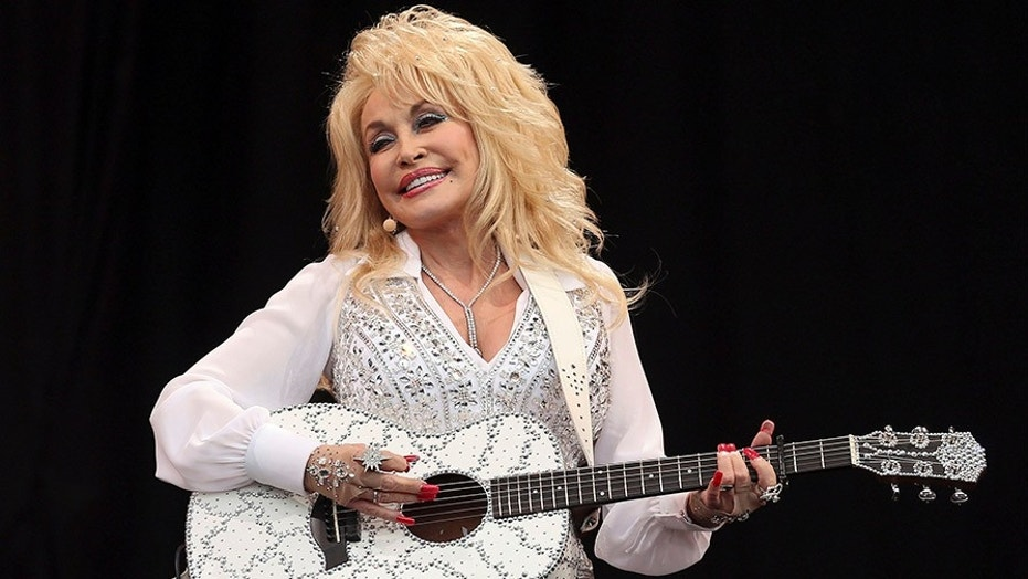 Dolly Parton performs on the Pyramid Stage at Worthy Farm in Somerset, during the Glastonbury Festival June 29, 2014.