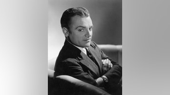 (Original Caption) Close-up of actor James Cagney sitting on a sofa with his arms folded across his chest. Undated publicity still.