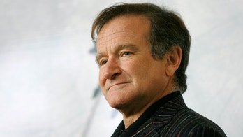 U.S. actor Robin Williams poses for photographers during a photo call in Rome November 15, 2005. Williams is in Italy to promote his latest movie 'The Big White', opening on November 18. REUTERS/Alessia Pierdomenico - RP2DSFHVKPAB