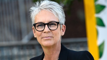 "FILE - In this Oct. 9, 2017 file photo, Jamie Lee Curtis arrives at the Los Angeles premiere of ""Jane"" at the Hollywood Bowl in Los Angeles. Curtis on Friday, July 20, 2018, comforted an emotional fan at Comic-Con who told a packed hall that Curtis' character in ""Halloween"" had saved his life after he went through a home invasion. The actress took the unusual step of leaving the stage where she was discussing an upcoming ""Halloween"" film to share a quiet moment with the man. (Photo by Chris Pizzello/Invision/AP, File)"
