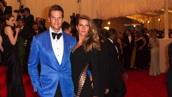 "Model Gisele Bundchen arrives with quarterback Tom Brady at the Metropolitan Museum of Art Costume Institute Benefit celebrating the opening of ""PUNK: Chaos to Couture"" in New York, May 6, 2013. REUTERS/Lucas Jackson (UNITED STATES - Tags: ENTERTAINMENT FASHION SPORT) - GM1E9570U4001"