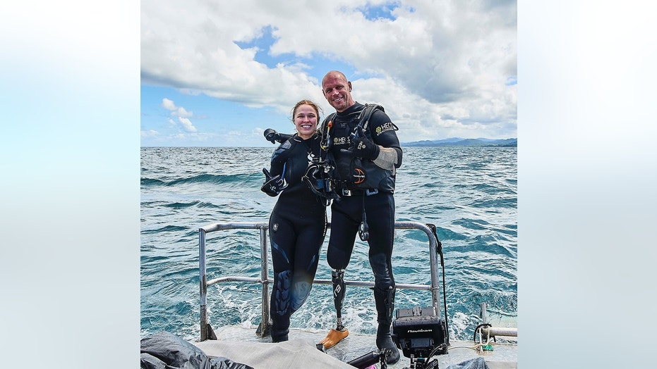 "Ronda Rousey and Paul de Gelder pose before their dive beneath the waters off the Fiji coast. ""Ronda Rousey Uncaged"" airs Monday, as part of Discovery Channel's annual Shark Week."