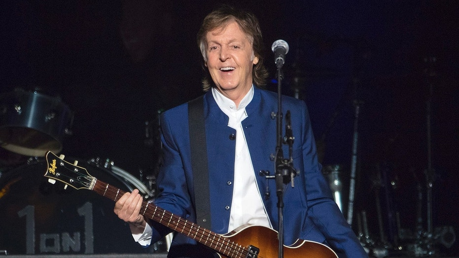 Paul McCartney recreates Beatle walk across Abbey Road
