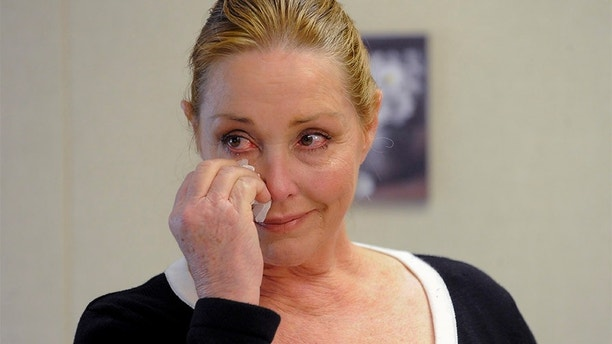 Debra Tate, sister of slain actress Sharon Tate, reacts after convicted mass murderer Charles Manson was denied parole at his 12th parole hearing for the 1969 Tate-Labianca murders, April 11, 2012. Manson was convicted for the August 9, 1969 Tate-Labianca murders and has been in prison for the past 40 years after California did away with the death penalty. REUTERS/Gus Ruelas (UNITED STATES - Tags: CRIME LAW CIVIL UNREST) - GM1E84C08V501