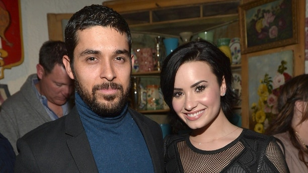 """LOS ANGELES, CA - JANUARY 20:  Wilmer Valderrama and Demi Lovato celebrate Nick Jonas' song """"Jealous"""" being the #1 At Top 40 radio hit at The Ivy on January 20, 2015 in Los Angeles, United States.  (Photo by Charley Gallay/Getty Images for Island Records)"""