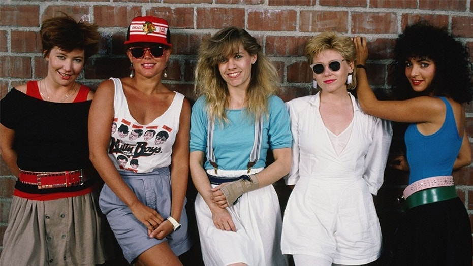The Go-Go's, (L-R) Gina Schock (drums), Belinda Carlisle (lead vocals), Charlotte Caffey (lead guitar), Kathy Valentine (bass), and Jane Wiedlin (rhythm guitar), playfully pose during a 1985 Hollywood, California, portrait session.