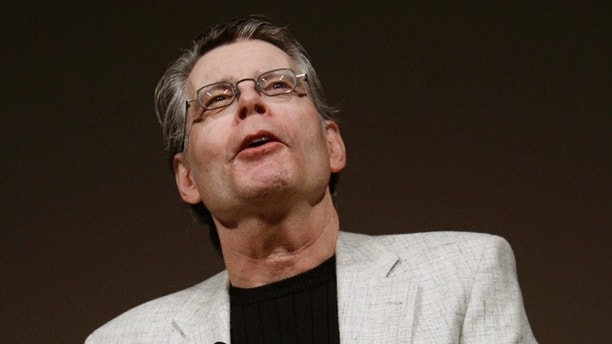 Author Stephen King speaks at a news conference to introduce the new Amazon Kindle 2 electronic reader in New York, February 9, 2009. The Kindle 2, the latest incarnation of the digital book reader is a slimmer version with more storage and a feature that reads text aloud to users.