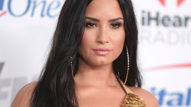 In this Dec. 1, 2017 file photo, Demi Lovato arrives at Jingle Ball at The Forum in Inglewood, Calif.