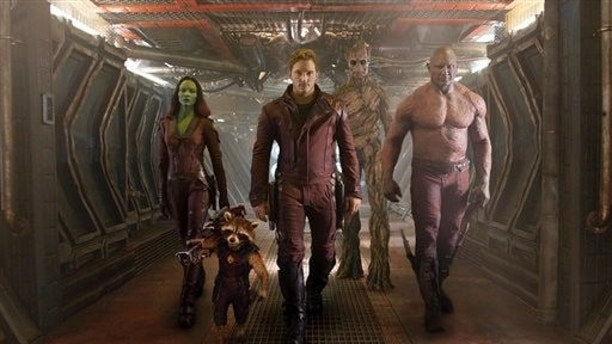 """This image released by Disney - Marvel shows, from left, Zoe Saldana, the character Rocket Racoon, voiced by Bladley Cooper, Chris Pratt, the character Groot, voiced by Vin Diesel and Dave Bautista in a scene from """"Guardians of the Galaxy."""" The movie releases on Friday, Aug. 1, 2014. (AP Photo/Disney - Marvel)"""